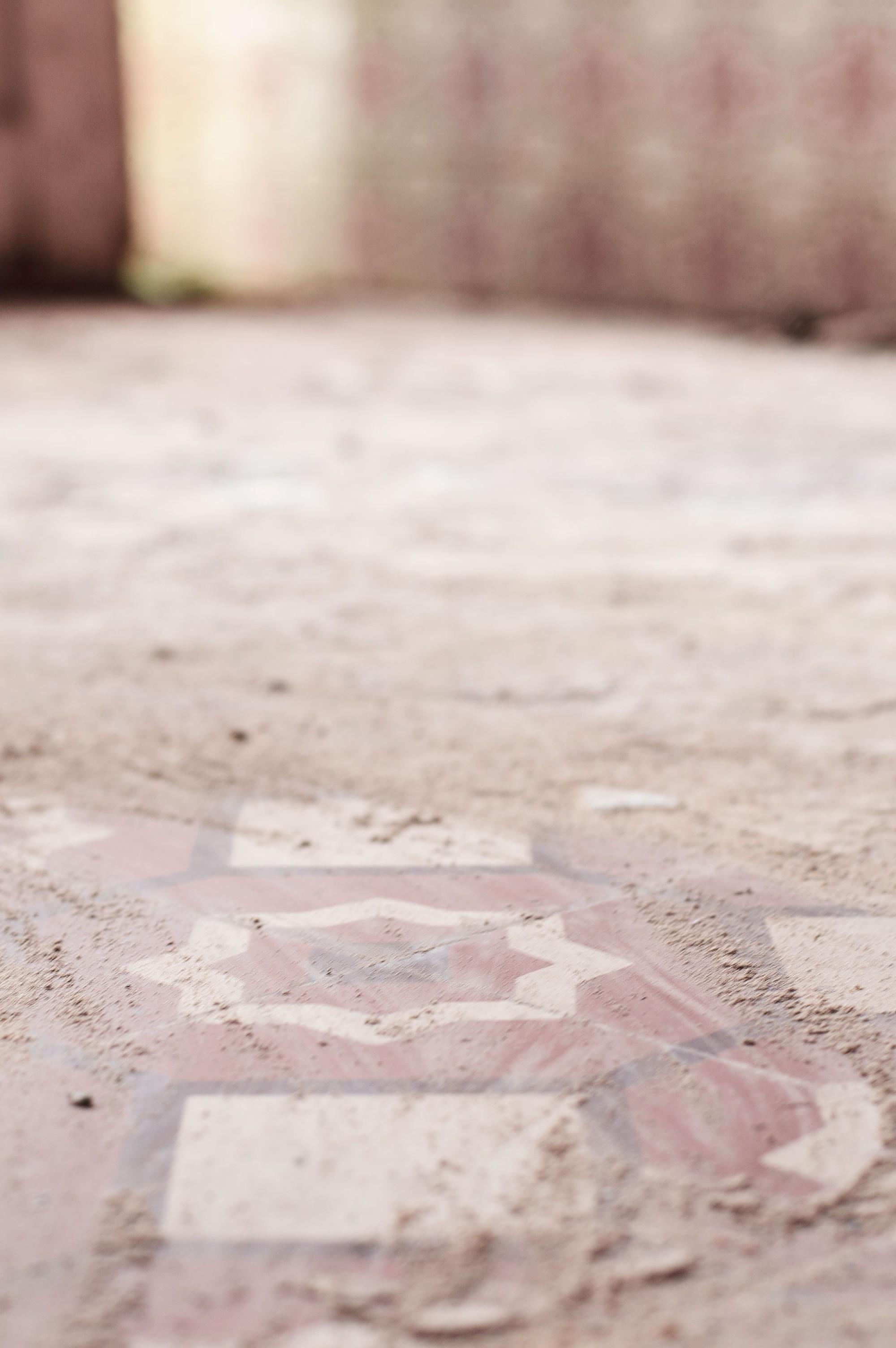 Original, mosaic tiles on ground floor.